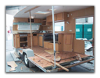 Still stripping the caravan with destroyed rear end